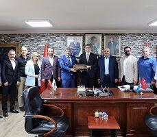 KOTO'dan, MHP İl Başkanı Kurt'a hayırlı olsun ziyareti